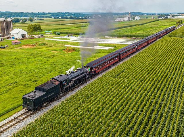 Chugging through lush farm fields, a steam locomotive navigates the oldest continuously operating railroad in the Western Hemisphere.