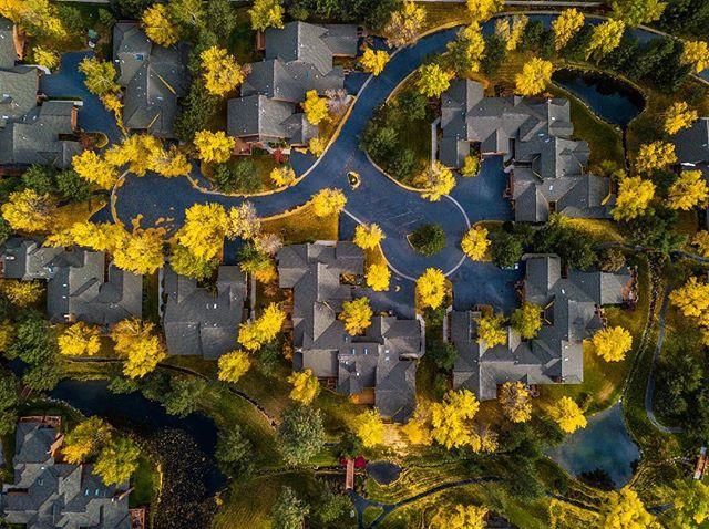 Autumn colors erupt across a quaint Montana suburb.
