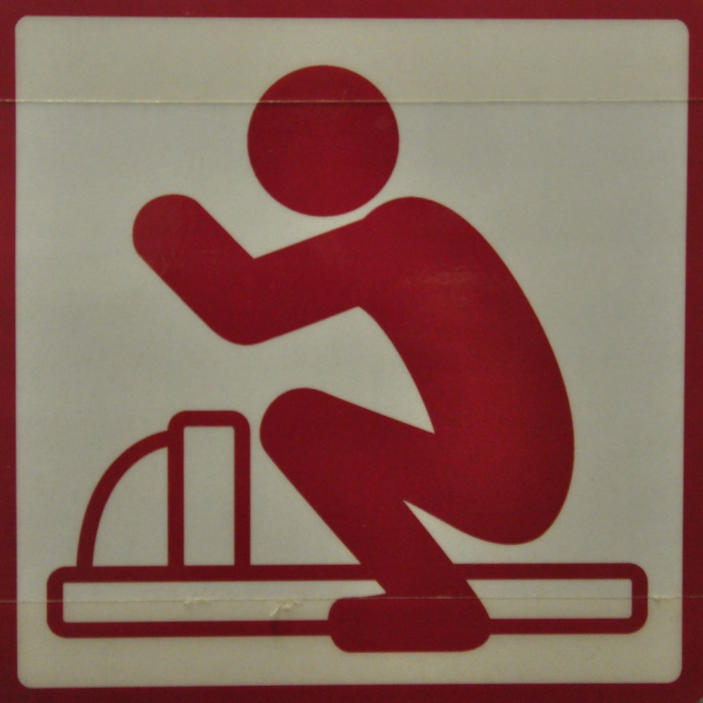 The proper technique for using an Asian squat toilet
