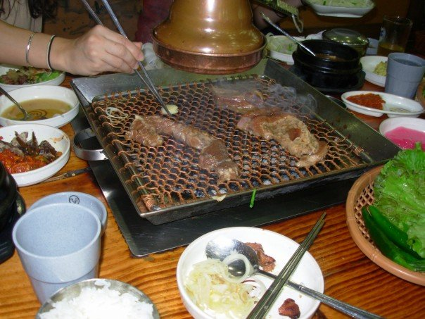 Cooking on a grill at a restaurant table - I may be a vegetarian now, but I sure would not have made it through two years in Korea.
