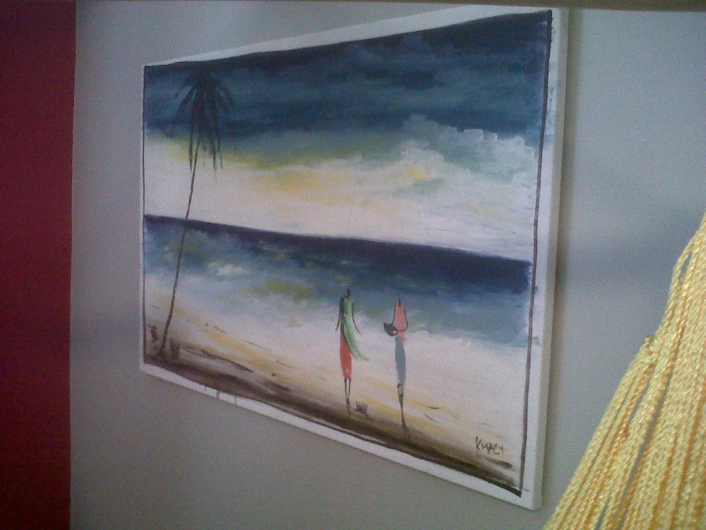 A painting from Ghana, on the wall behind the hammock