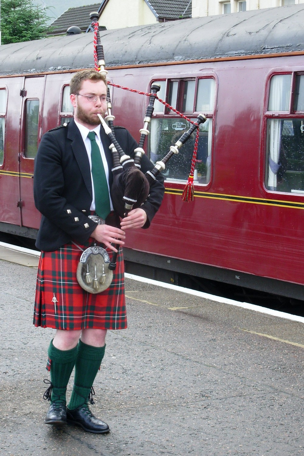 bagpiper playing at a train station