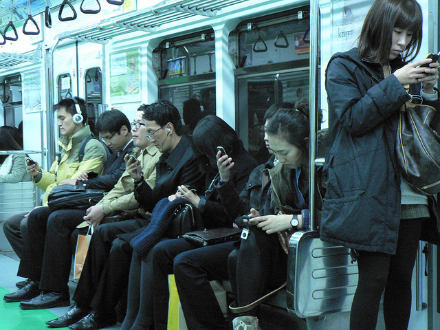 A much safer alternative: texting on the subway (photo credit: https://www.flickr.com/photos/marc_smith/5166351572)