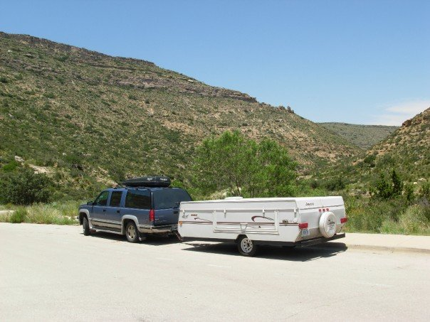 Our Suburban truck and tent trailer on a family vacation many years ago. Probably half the stuff in the truck is Mom's...just kidding! It's probably snacks for the four kids.