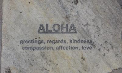 Aloha written on a sidewalk in Waikiki