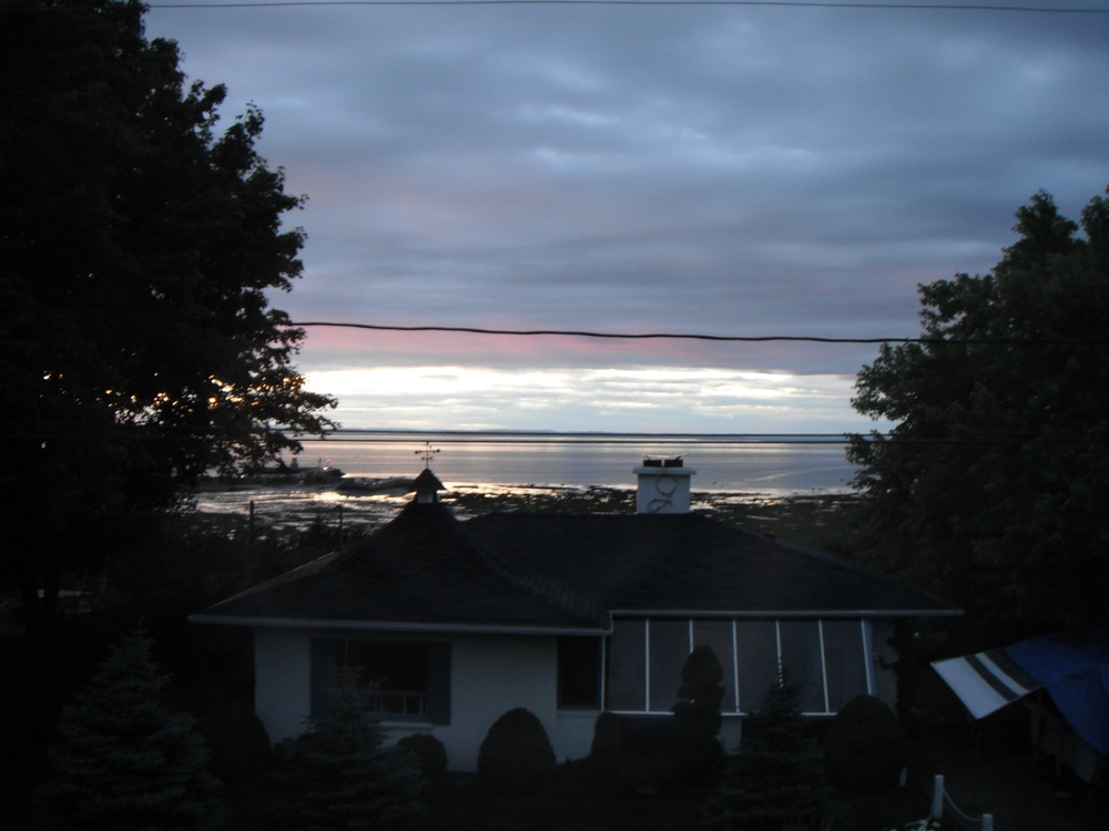 Travel like a local tip #5: Stay with a local. During my homestay in Quebec, Canada, I got to wake up to this lovely view of the St. Lawrence River.