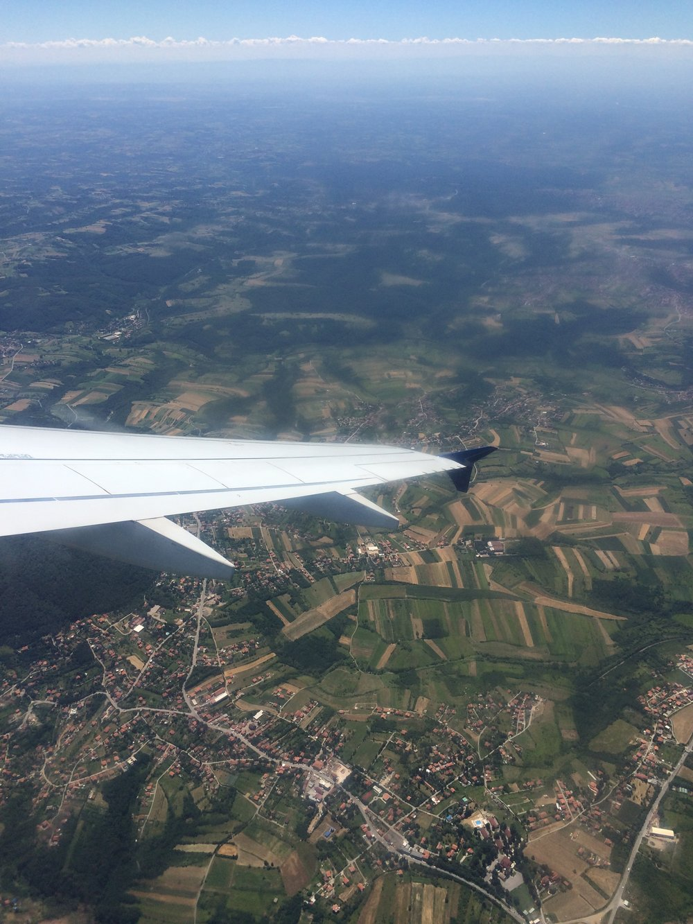 In flight over green fields, somewhere between Belgrade and Athens