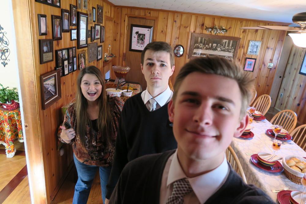 Elder Larson & Elder Bronson at Bro. Maldonado's house for Thanksgiving dinner. No idea who the girl is.