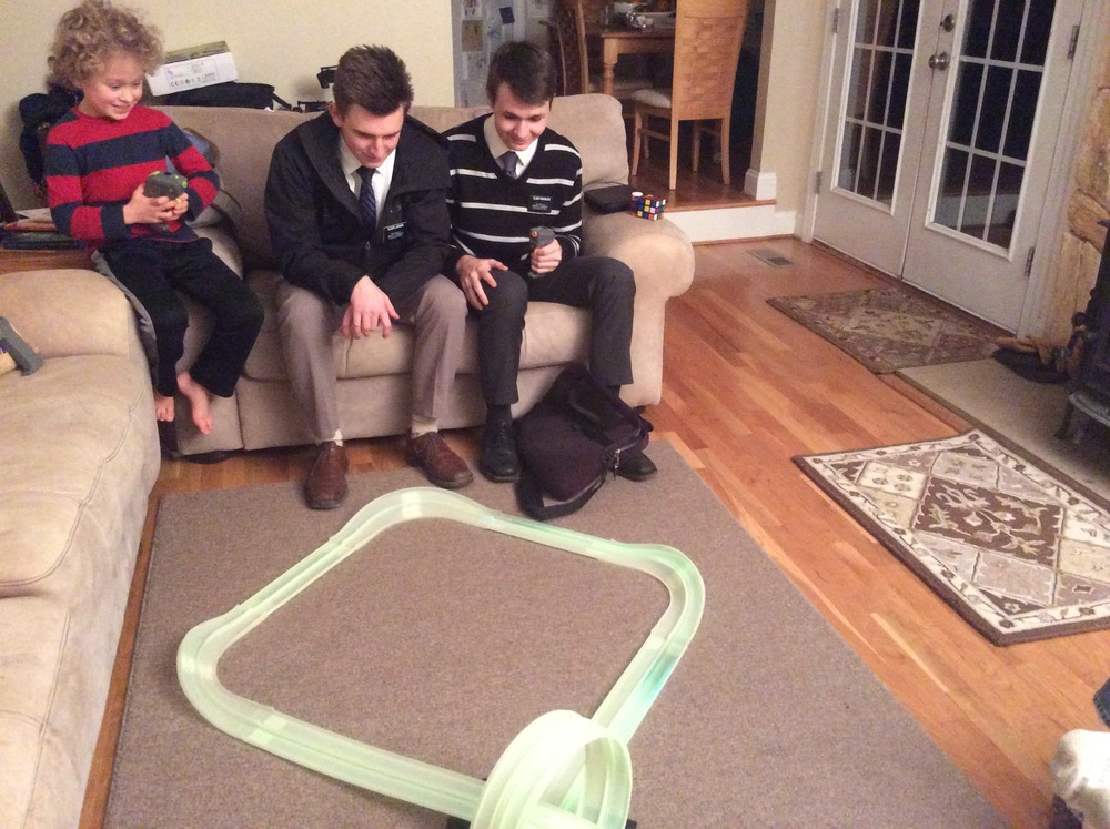 Elder Larson, Elder Bronson and Ben racing cars.