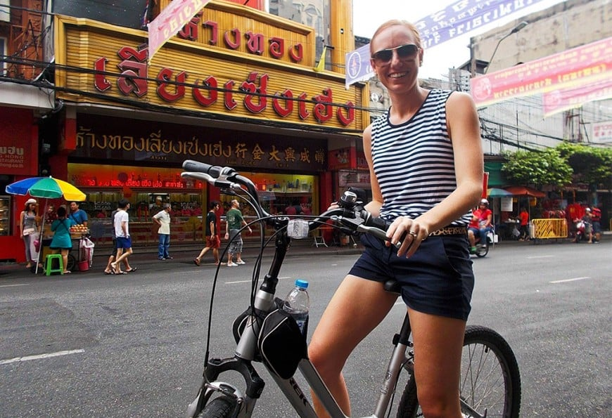 Writer Ainslie Young riding bike in Bangkok