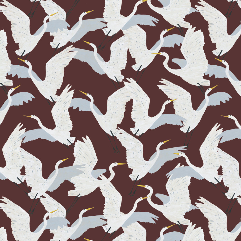 white herons in flight pattern
