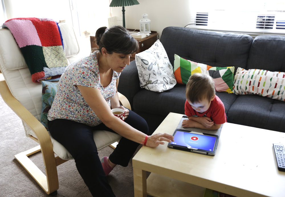 Inma, a Microbiologist from Spain, playing with her son Matias. Nottingham, July 2016.