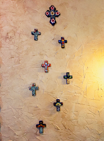 The entrance wall of our home bears the remembrance to our little angels as it displays a cross for each family member, including Jonathan and Joseph, with the largest cross at the top symbolizing God as the head.