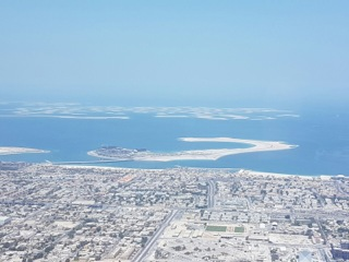 Dubai City Spilling Into The Desert And The Sea