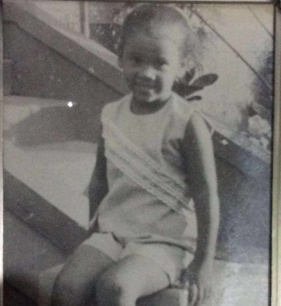 Five year old me - sitting of the steps at my grandparent's farm in St. James, Jamaica, just before leaving for England.