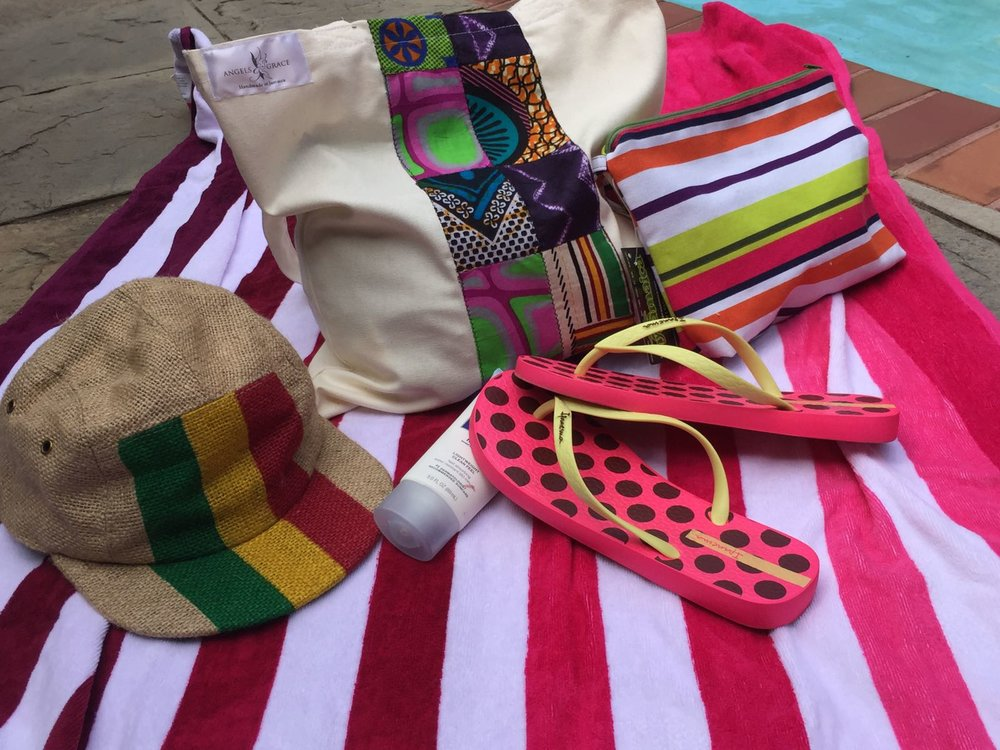 (L - R) Striped Burlap Cap - $2100; African Colour Block Tote - $1850; Striped Wet-Bikini Bag - $1850 - My Jamaica  IPanema Flip Flops - $2520 - Fontana Pharmacy
