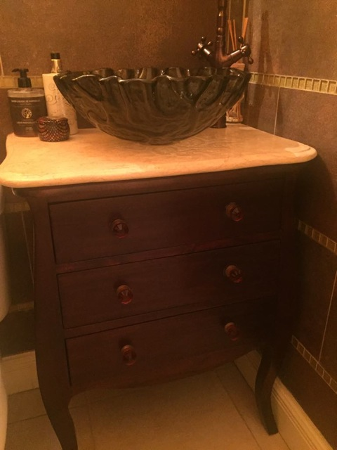 This old cabinet was fit with plumbing, new crystal pulls, a marble counter top and beautiful vessel sink for a powder room 'POW'!