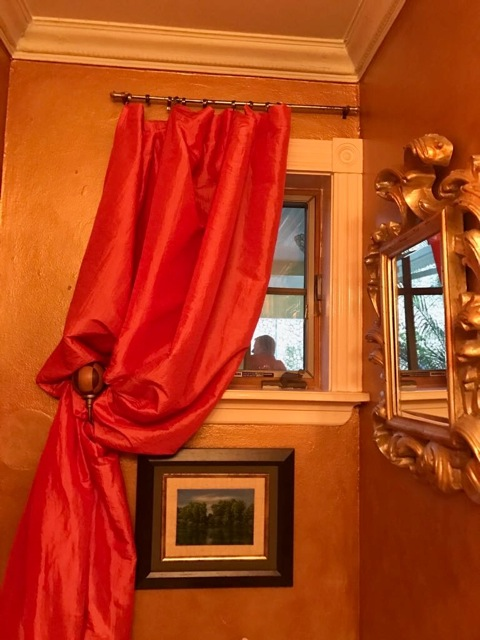 A silk swag curtain adds a touch of formality to this powder room