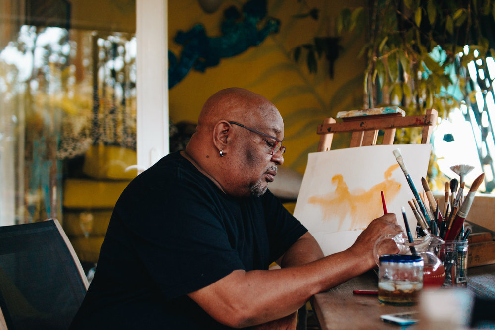 One of the Caribbean's leading watercolour artists and a graduate of the American Academy of Art in Chicago, Patrick has had numerous one man shows in the major Galleries in Jamaica, and he has also participated in many group shows. His work has been exhibited in New York, and is represented in private collections in the U.S.A., the United Kingdom, Canada and Jamaica. It has also been recognized by American Artist Magazine, and was published in 'Watercolour 92', their exclusive watercolour bi-annual issue and International Artist Magazine. He has just completed the execution of murals for the Bank of Jamaica. In addition, he was responsible for the decor for the opening night of the Midem Music Festival 1997 in Cannes, France. VISIT HIS WEBSITE