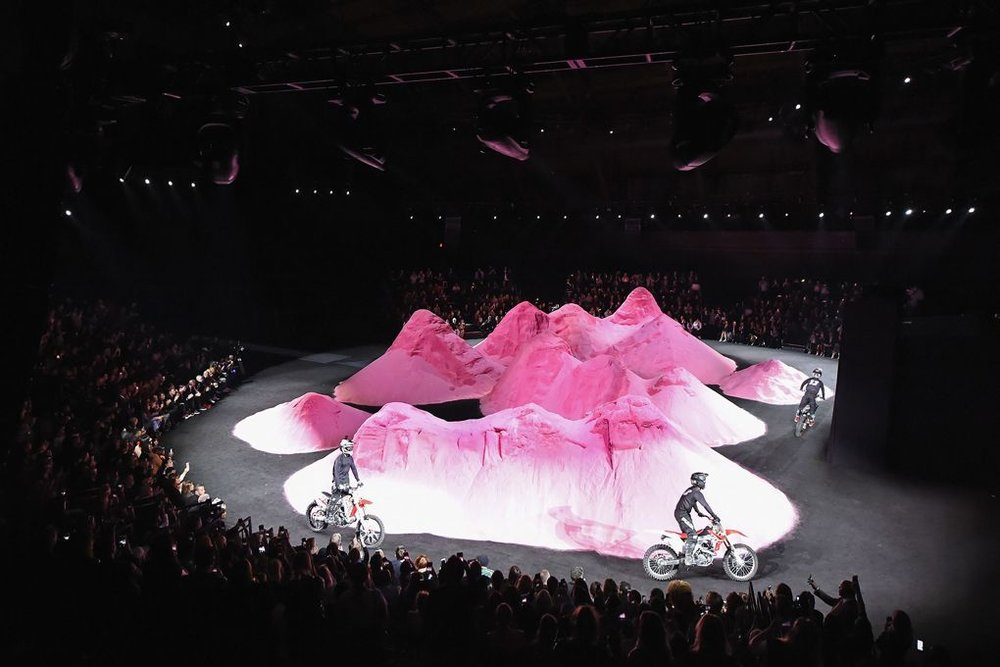 #2 The Millennial Mountains - Pastel peaks of sand erupted from the floor of the Park Avenue Armory, as Rihanna staged her Fenty spring/summer 2018 show against a millennial-pink mountain range. Motorcyclists zoomed from glitter-strewn piste to piste, and got fashion editors G-ed up about the fast and furious show.