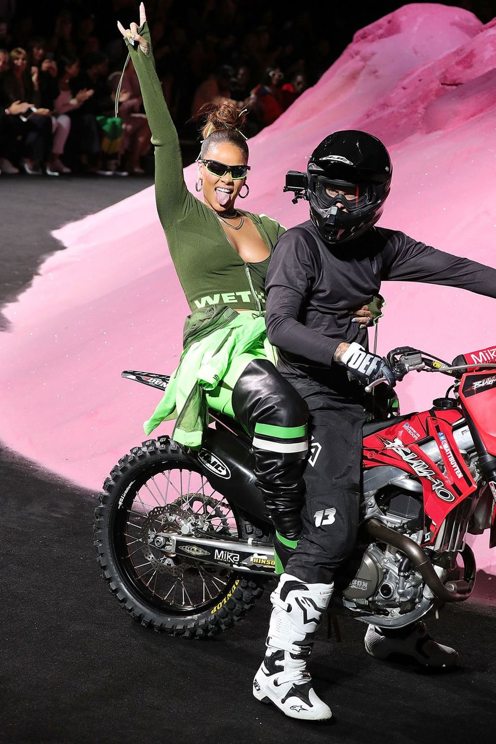 "#3 The Motorcross Mania - RiRi eschewed the traditional designer post-show wave and bow in favour of a victory lap on the back of a motorbike – tongue out, hand above head in the gutsy ""rock on"" signal. There's a reason why the popstar-turned-designer's Instagram handle is ""badgalriri"", and Sunday night she reasserted that when she goes to werk, she's the boss."