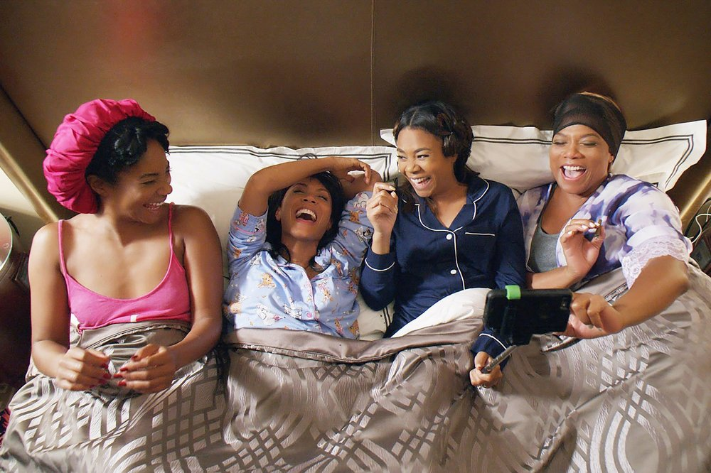 GIRLS TRIP -                                                                  (2017)You get by with a little help from your friends. When you're recovering from a break-up, it's best to surround yourself with your clan, like the women in this hilarious, raunchy film do. Ryan (Regina Hall), Sasha (Queen Latifah), Lisa (Jada Pinkett Smith), and Dina (Tiffany Haddish) travel to New Orleans for the annual Essence Festival, and hijinks follow.