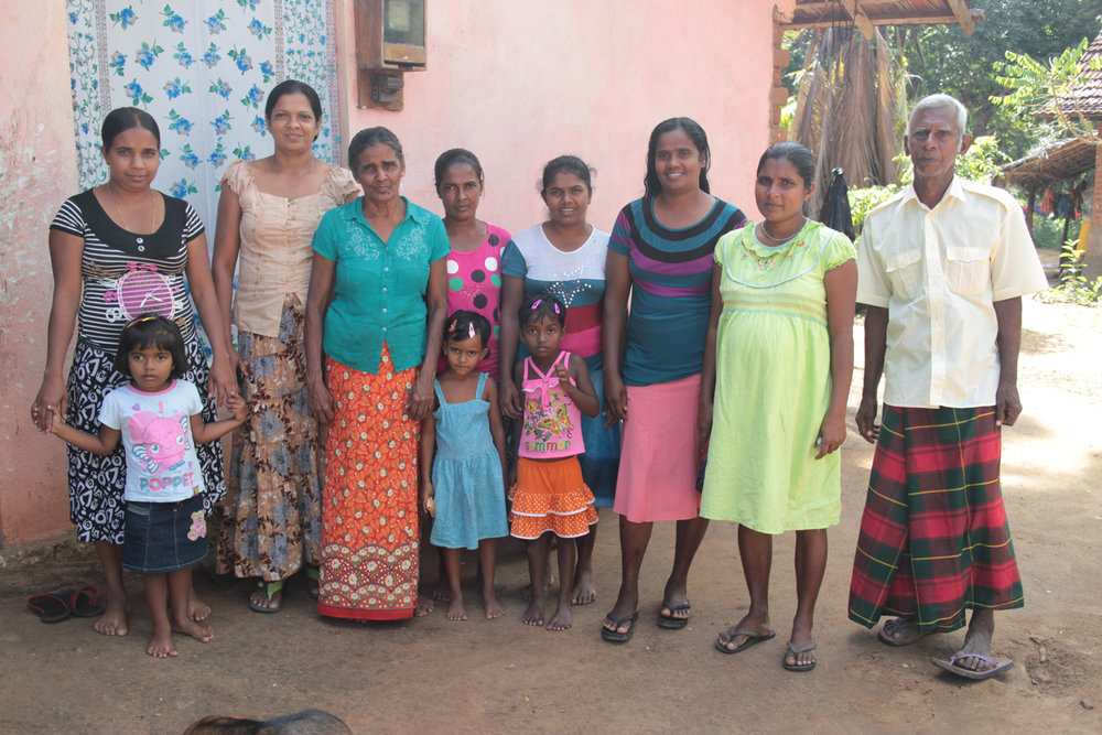 Grandmother (third from left) with one of the savings groups in the village.