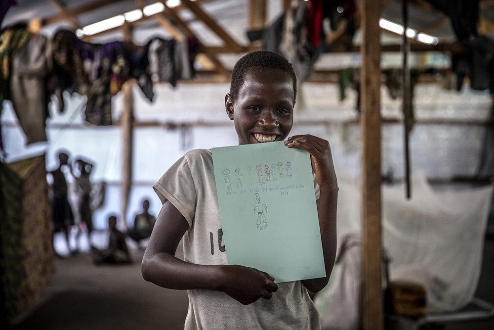 20180628_WCH_DRC_Congo_Mulongwe_Burundian_refugee_camp_Nina_drawing_family_Jeppe_Schilder_03.jpg