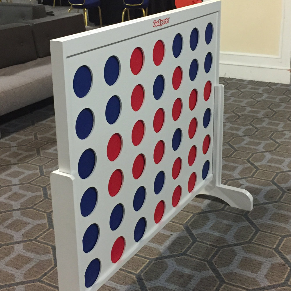 "[Photo: Life-size ""connect four"" game.]"