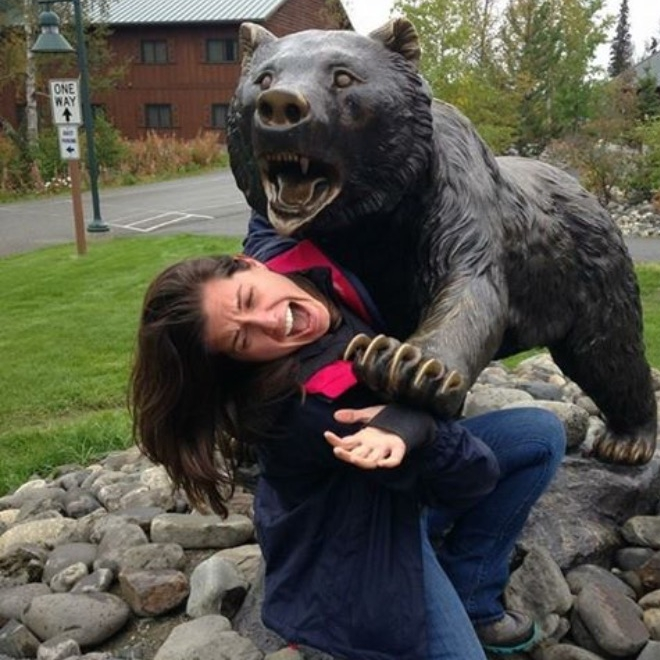 "[Photo: Bear statue ""attacking"" a woman much too mature for this level of silliness.]"