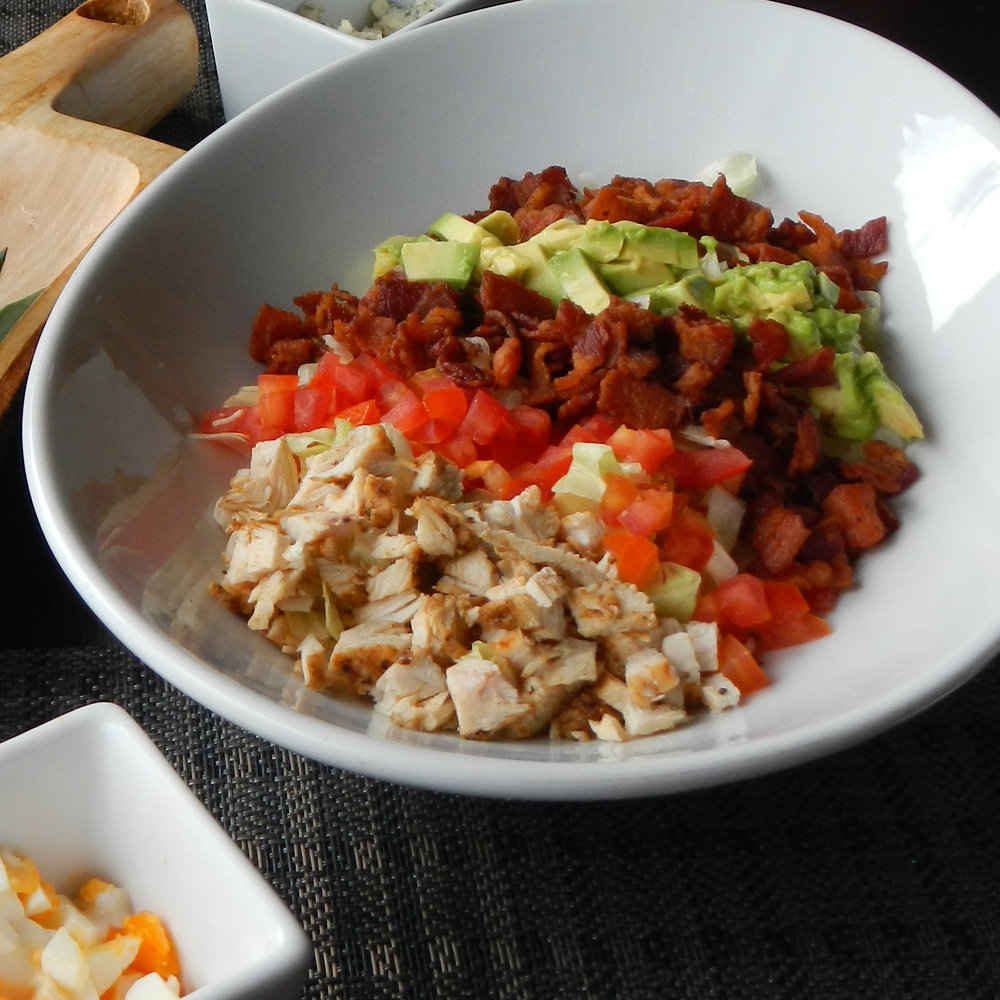 [Photo: Cobb salad in a white bowl]