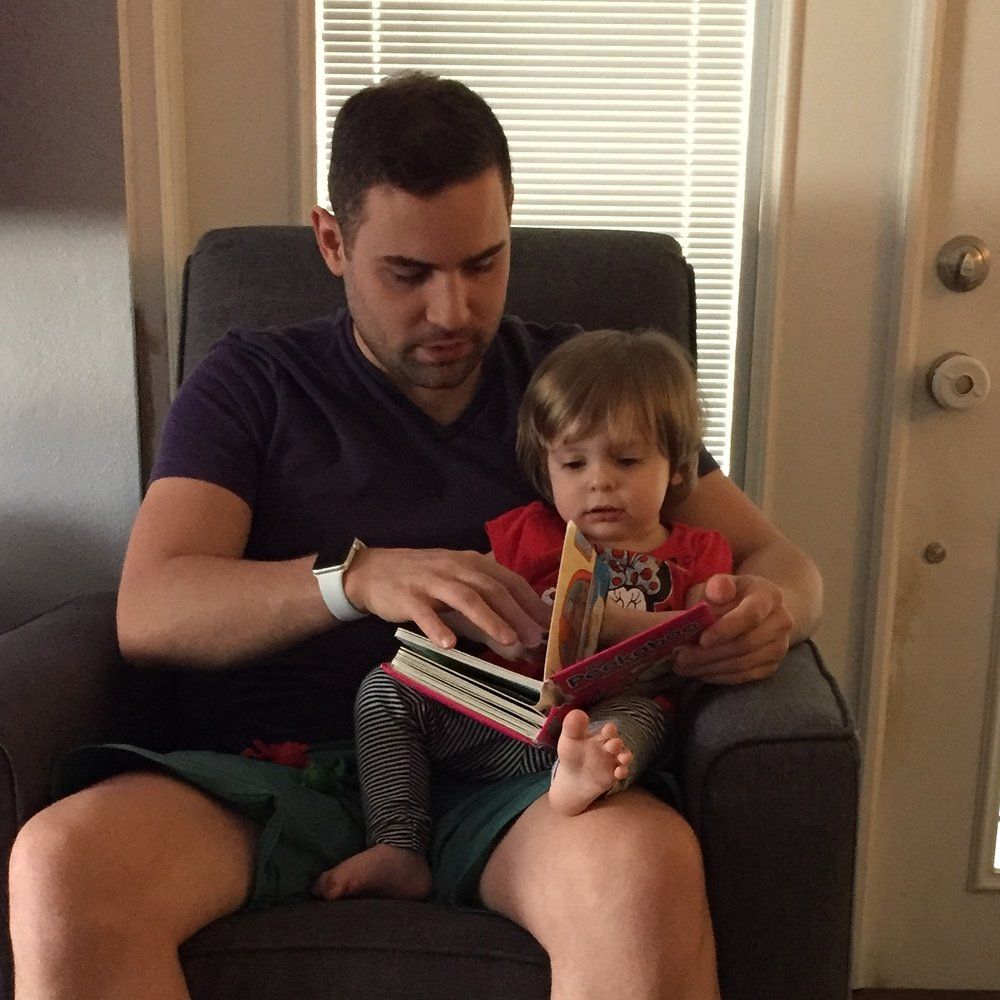Photo of baby Bella and Uncle Cory reading a book. What books did you love as a child?