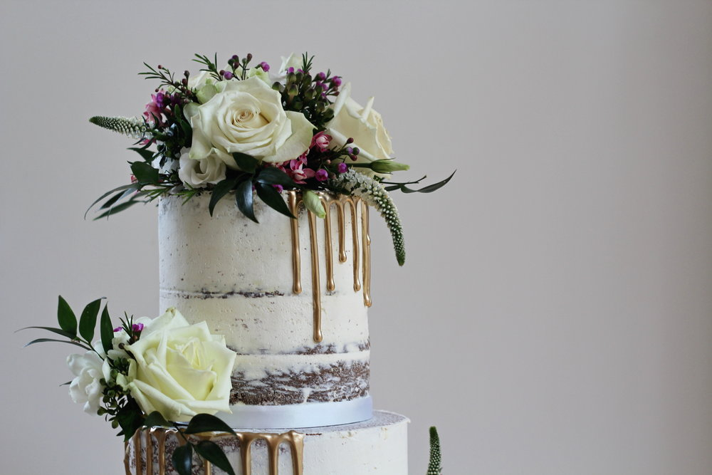 The Confetti Cakery semi-naked, gold drip wedding cake