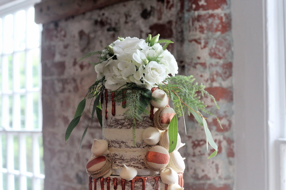 Copper drip semi-naked wedding cake The Confetti Cakery