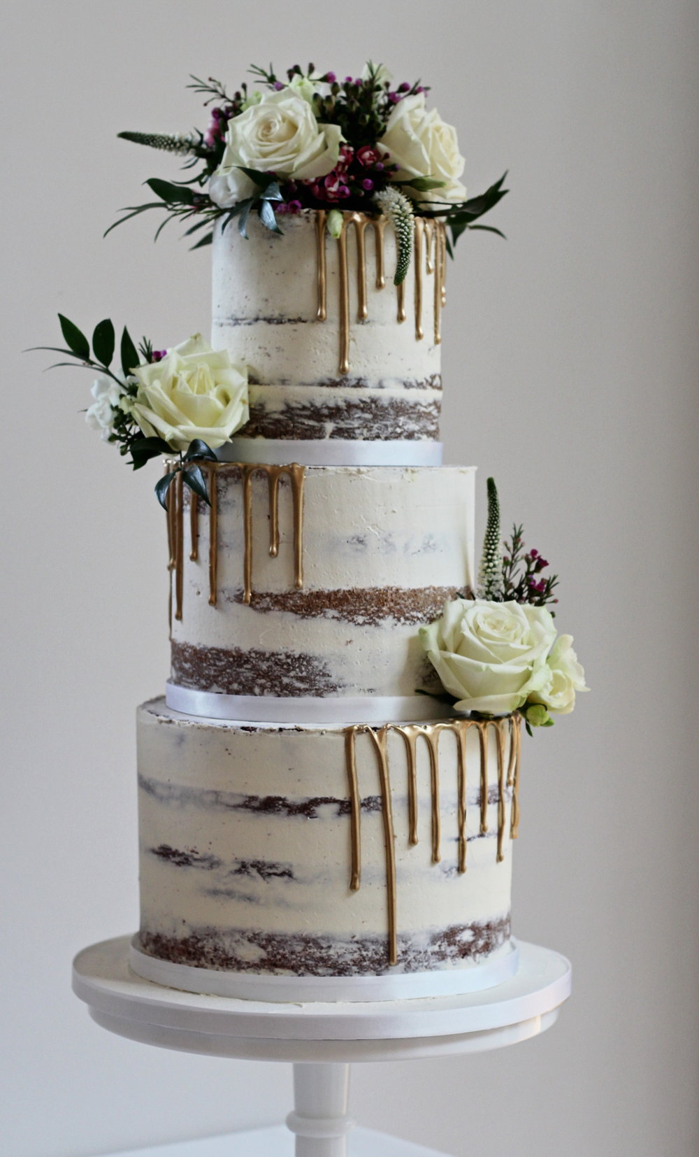 Gold drip semi-naked wedding cake The Confetti Cakery