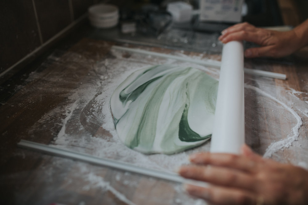 Rolling out marble sugar paste.
