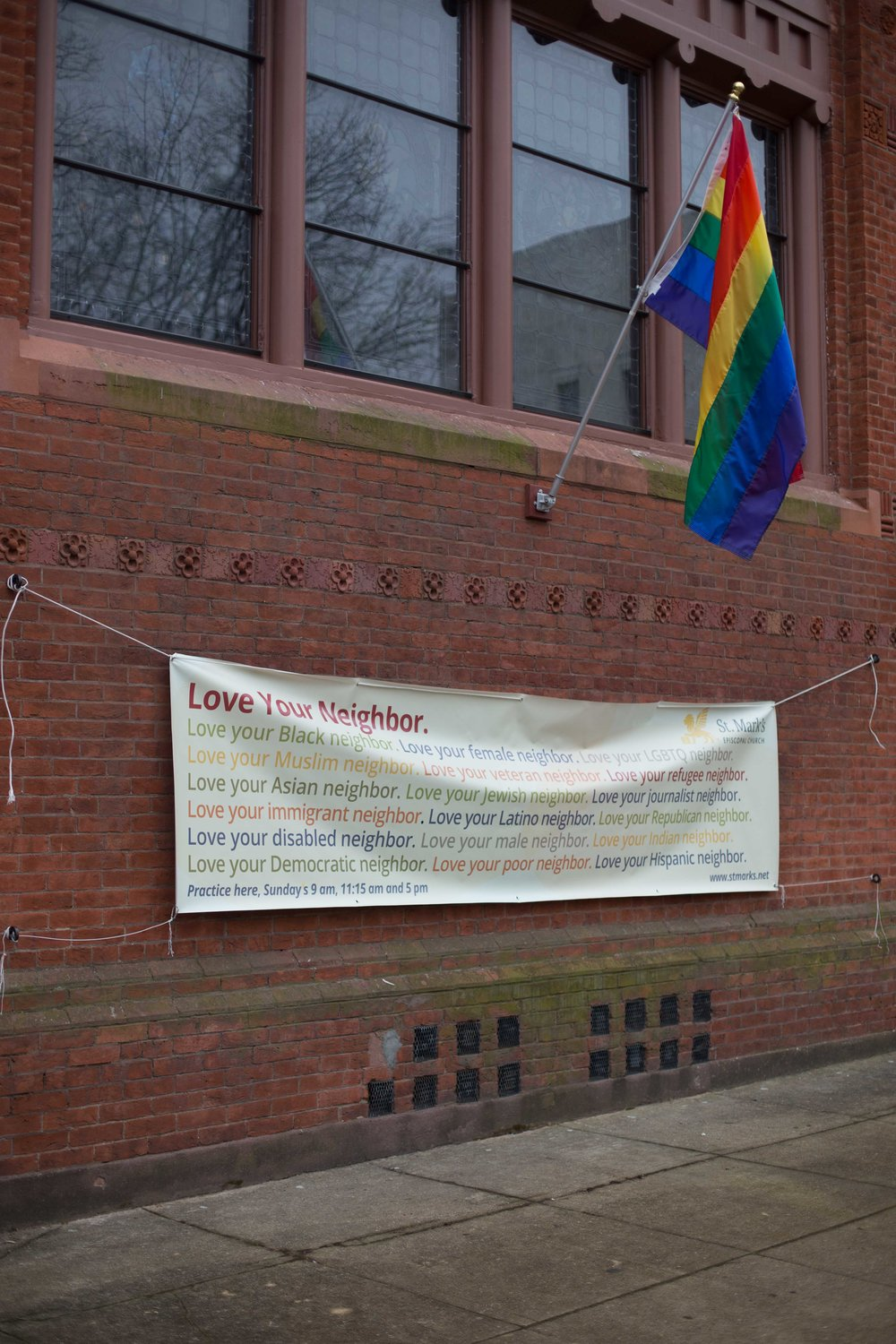 The outside of  St. Mark 's is decorated with welcoming signage