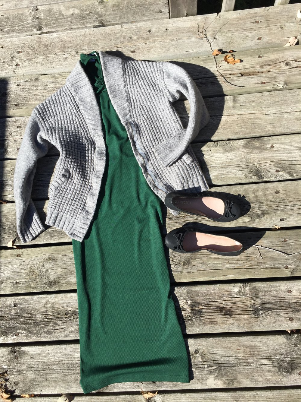Green midi dress with grey grampa style sweater and black flats