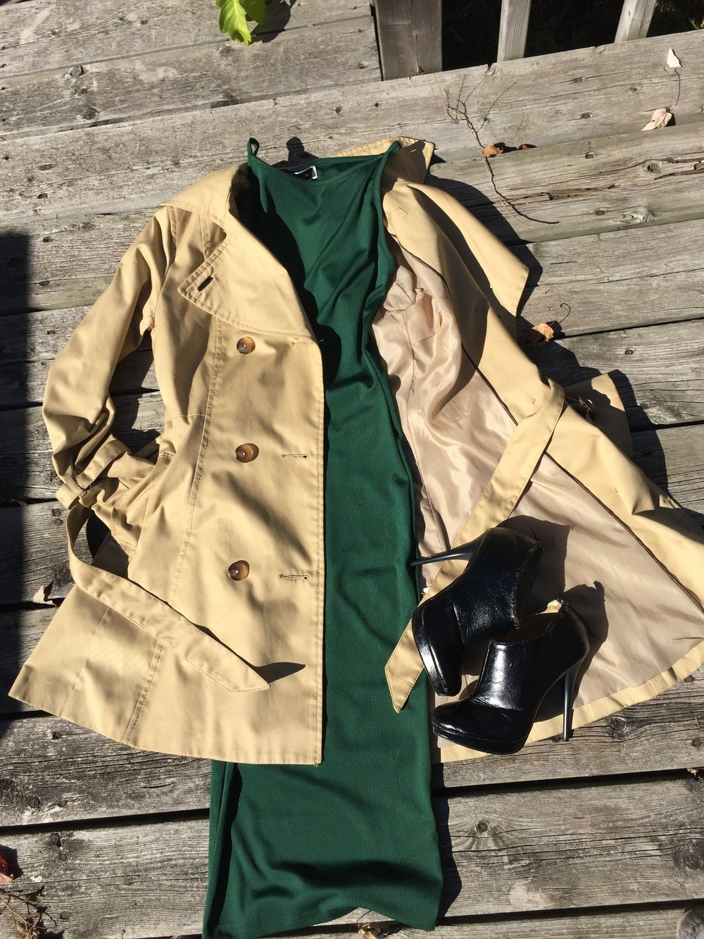 Green midi dress with flared  tan trench coat, black booties