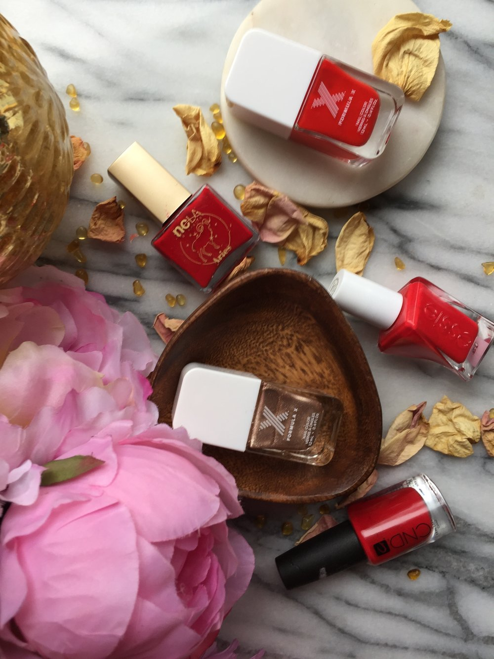 NCLA Aries, CND Rouge Red, Essie Rock The Runway, Formula X Haute Sauce and Formula X Revved Up