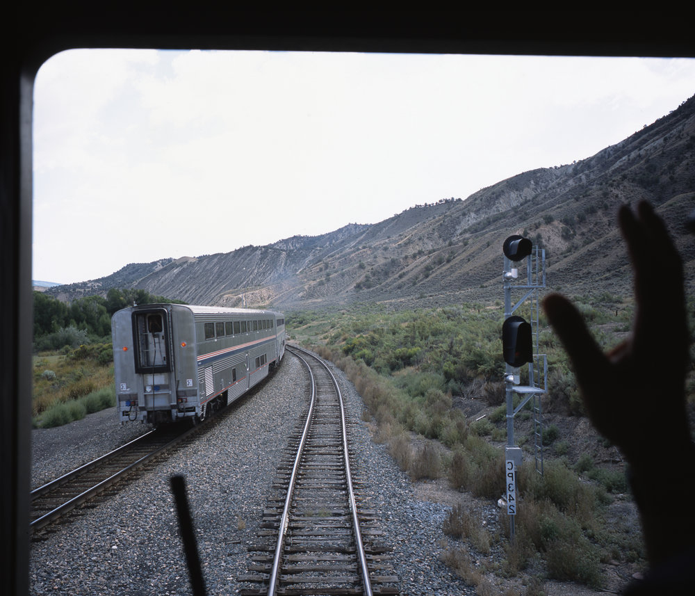 The westbound California Zephyr passes as our conductor waves at theirs