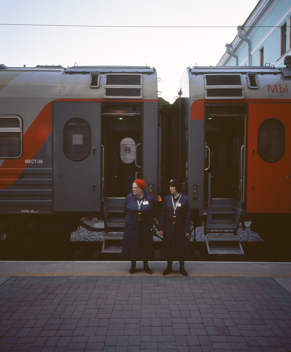 Our car attendant on the left, the other deluxe car's attendant on the right Fuji GF670w | Kodak Portra 400