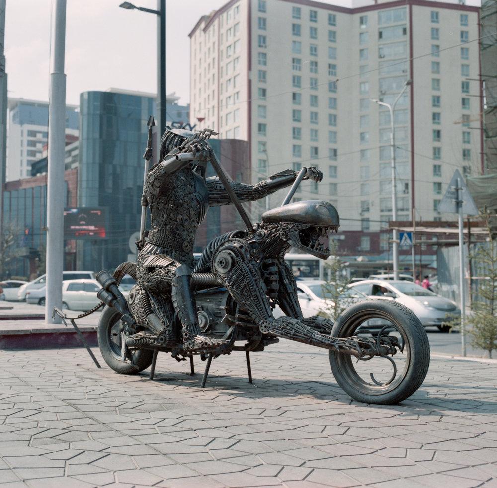 Predator riding Alien, made out of nuts, bolts, and random parts Fuji GF670 | Agfa Vista 400