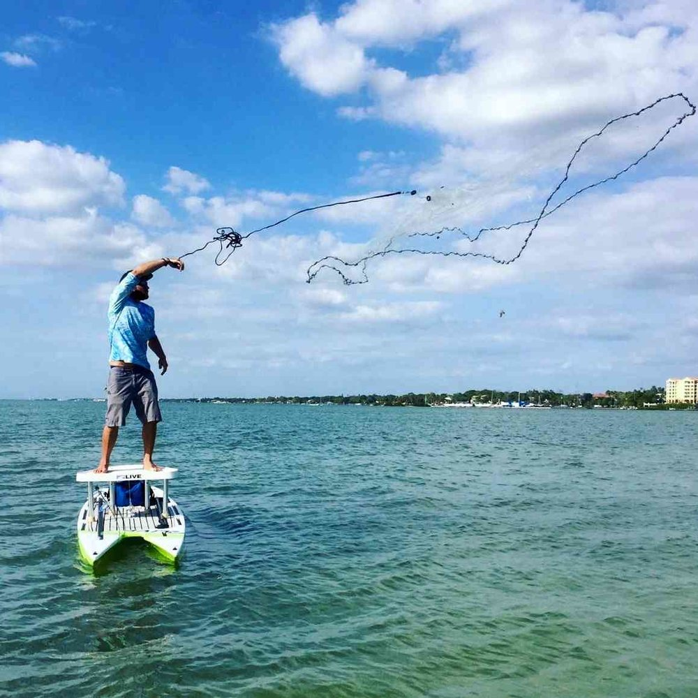 Greg Cody showing good form tossing a casting net off his casting platform from his L2Fish paddle board