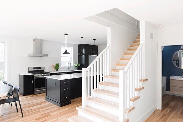 Bright, airy, and open main floor, with the addition of a second story to accommodate this growing family. #yyj #yyjdesign #interiordesign #thicktreads #navypowderroom #blackcabinets #homerenovation #kitchendesign #kitchenandbath