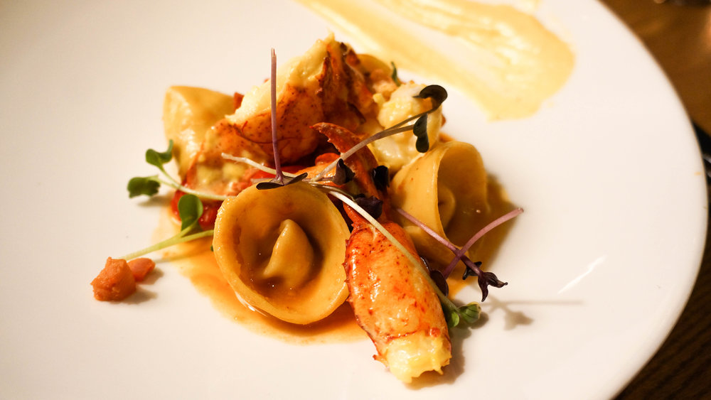 Saffron-butter poached lobster, chorizo, fennel, and orange tortellini in a bouillabaisse broth, rouille.