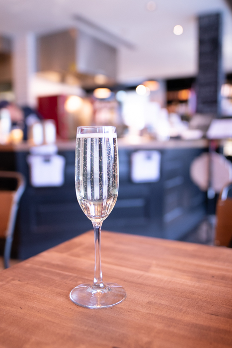 Enjoying a glass of Prosecco at Meat & Cheese