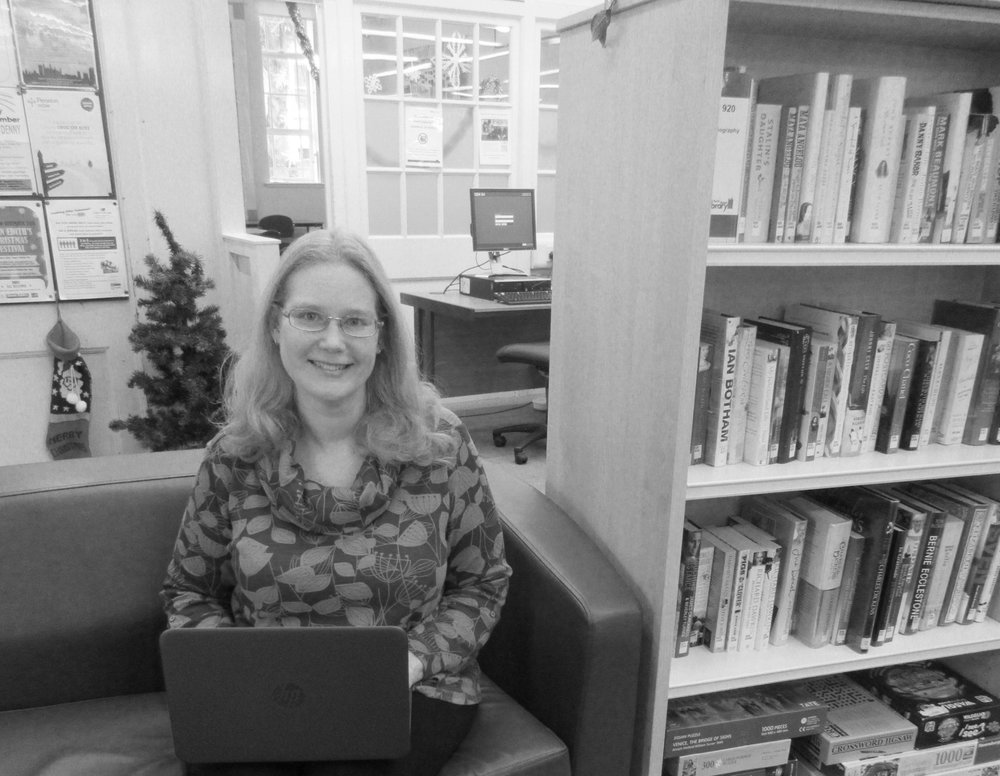 Ingrid likes to write at the library near her daughter's nursery.  She tells us it's a 30 minute cycle between home and nursery, so it's much more efficient for her to drop off her daughter and then work at the library for a couple hours before picking her up.  This is her favourite chair,  right next to a very convenient hot drinks machine :)