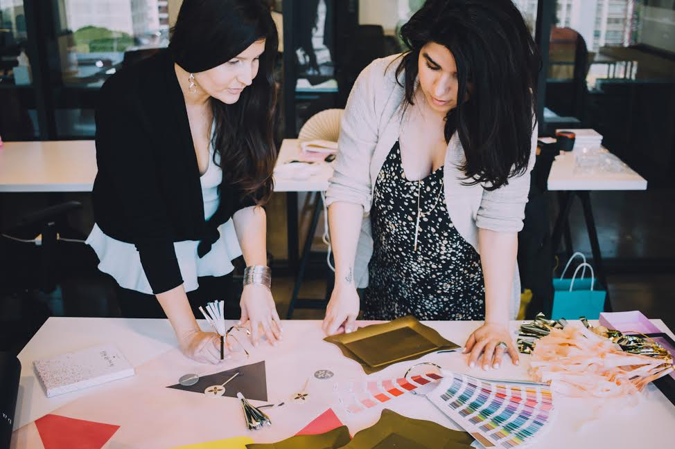 Niku and Susy reviewing some of Paris312's latest designs