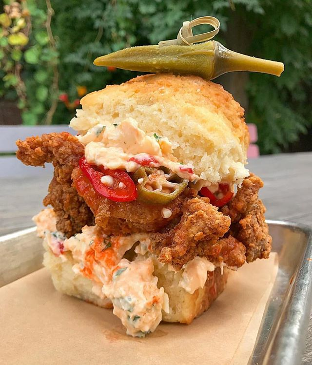 "This hazy Chicago day has us craving comfort food and @honeybutterchi x @bangbangpie delivered!! The ""Bang Bang Hot Pickle"" has an extra crispy fried chicken thigh, two layers of pimento cheese, spicy pickled fresno chilis & cucumbers - all dripping in hot sauce! Grab it at 3361 N Elston until Sunday! 😋 📸: @honeybutterchi"